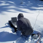 A researcher downloads data onto a laptop at one of the gap sites.