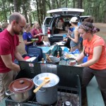 Students at camp cook stoves