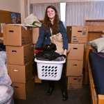 Student Heather Huizenga gets ready to leave her Terry Hall room, having packed her belongings in boxes. When she comes back from holiday vacation to begin winter quarter, her stuff will await her in a room in the new Lander Hall.