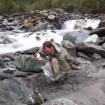 person in stream bed
