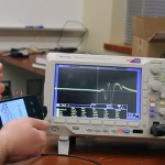 AllSee detects the unique signal changes (shown on the oscilloscope) and classifies a rich set of hand gestures.