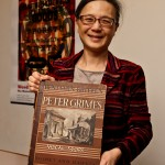 "Judy Tsou, head of the UW Music Library, with a copy of Benjamin Britten's opera ""Peter Grimes."" The score is part of a large donation to the UW by the estate music collector William Crawford III."