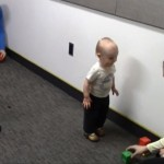 "During the ""choice trial"" of a research experiment, a baby chooses one experimenter to play with."