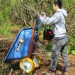 Man dumps wheel barrow of mulch
