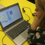 A second grade student participates in the 2013 Hour of Code.