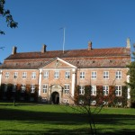 """Svanholm, a rural Danish community, is """"a prosperous and highly functional commune,"""" Litfin writes, with most of its 85 adults and 56 children """"living in small 'home groups' in this enormous 1749 manor house."""" She adds that the commune's 988 acres devoted to organic farming """"dwarf those of most ecovillages and its farmers have played a pivotal role in setting Danish — and therefore European Union — organic standards."""""""