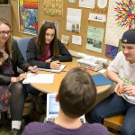 Elwood meets with students Stella Jones, left, Jackie Divita and Kendal Dressel to discuss their project.