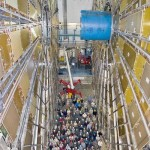 Scientists at the European Organization for Nuclear Research are dwarfed by the Atlas particle detector, part of the Large Hadron Collider.