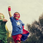 stock photo of children dressed as superheroes
