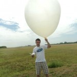 person with weather balloon