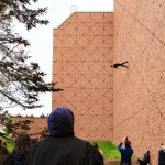 "Rachael Lincoln, UW dance lecturer and member of the BANDALOOP dance company, performs ""Man Walking Down the Side of a Building,"" by choreographer Trisha Brown on the west side of Meany Hall for the Performing Arts on Friday, Feb. 5. She was assisted from above by a colleague with BANDALOOP."