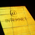 Internet sign reflected on tile floor