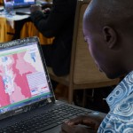 An attendee at an Ebola workshop in Ghana reviews IHME data.