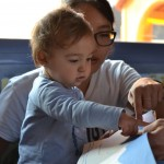 UW student Jinnie Yi works with a toddler at one of the participating infant education centers in Madrid. A study by the UW Institute for Learning & Brain Sciences shows that infants and young children can develop bilingual skills through interactive learning.