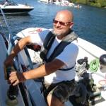 Terry Durfee pumps out a bilge on Lake Washington.