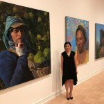Artist Arely Morales with her three paintings depicting immigrant workers at the 2017 MFA + Mdes Thesis Exhibition, at the Henry Art Gallery though June 25.