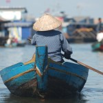 A women fishes in Tonle Sap Lake in Cambodia.