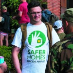 Forefront Program Coordinator Brett Bass joins fellow veterans to build awareness about the Save Homes, Suicide Aware program. Photo of Brett talking to two veterans,