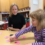 A study this summer will examine how the word-recognition portion of the brain develops in preschoolers. Photo of young child sorting cards with simple words on them.