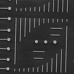 An image of small golden discs and rods used in an experiment