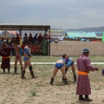 "Nadam, Mongolia's national festival to practice ""the tree games of men"": horseback racing, archery, and wrestling. The man of largest size in picture qualified to compete in the championships in Ulaanbaatar."