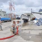 Cadets conducting shipboard firefighting drills.