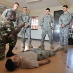 A Barbados Defense Force Medic teaching us first aid and combat trauma