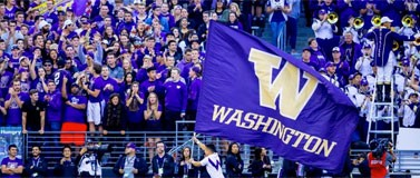 Cheerleader carriers UW flag