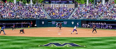 A photo of the UW Softball stadium looking from the outfield toward home plate.
