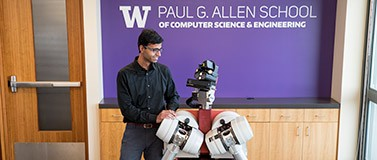 UW professor Siddhartha Srinivasa with HERB (Home Exploring Robot Butler)