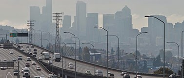 Cars travel on I-5 in Seattle