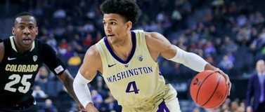 Matisse Thybulle running with basketball, Colorado player McKinley Wright IV in the background