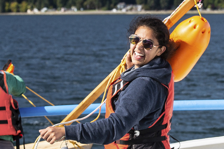 Deana Crouser on a deck of a boat, smiling in the sunlight