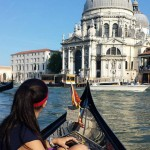 Graduate girl in the front of a gondola in Venice
