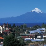 "Puerto Varas, also known as ""La ciudad de las rosas"" or ""the city of roses.""with Osorno Volcano and Llanquihue Lake are both visible in this photo"