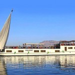 A dahabiya is a shallow-bottomed, barge-like vessel with two or more sails.