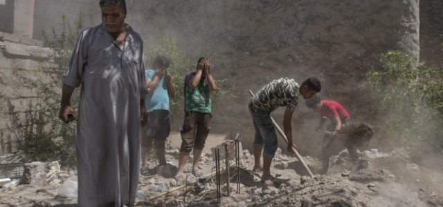 Underequipped and Unpaid, Mosul's Civil Defenders Reunite the Dead With the Living
