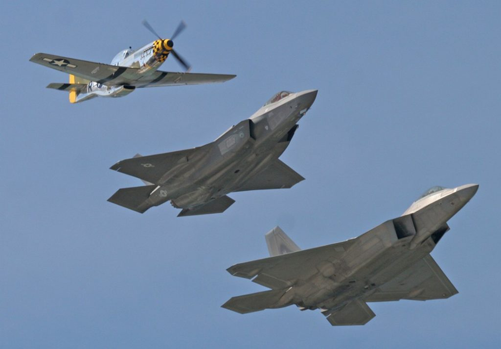 Lenoch flying in formation with an F-35 and an F-22. The Aviationist