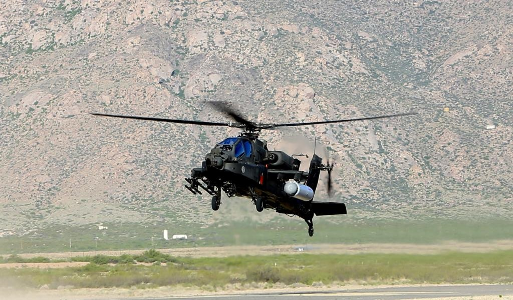 Image result for Laser Gun Fired From Apache Helicopter Successfully Hits Target Almost a Mile Away