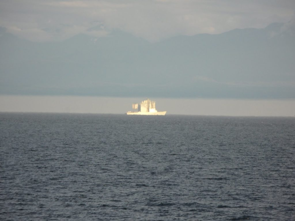 A superior mirage and atmospheric duct looking north to Vancouver Island/Victoria from the Strait of Juan de Fuca.