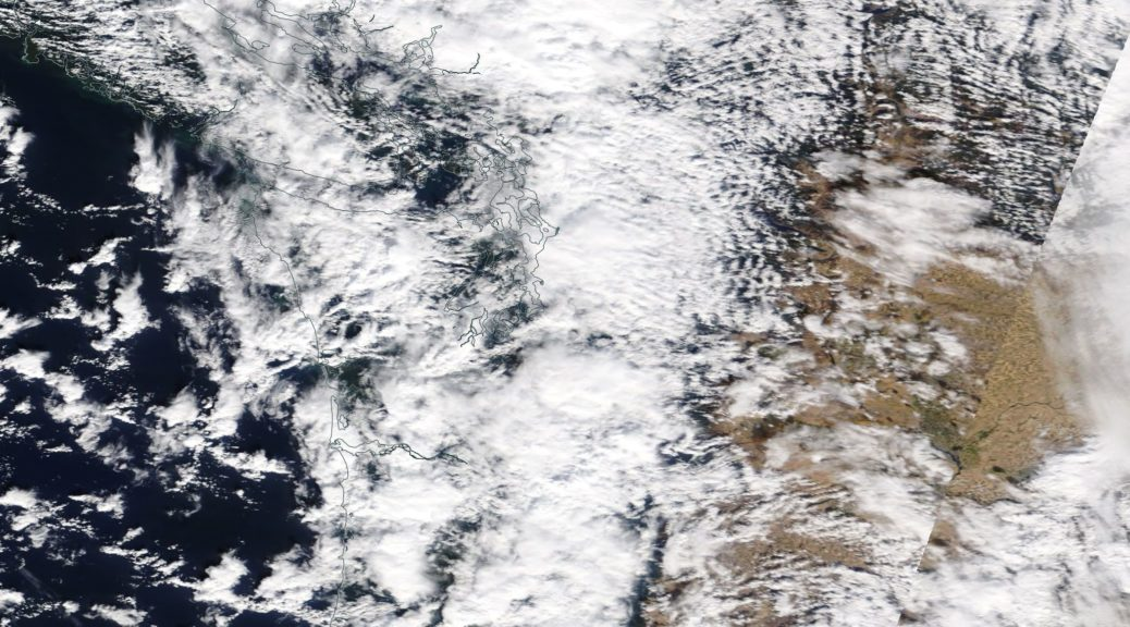 Scattered showers coming off the Pacific Ocean into the Pacific Northwest. Note the enhancement over the mountains and the clear skies over Eastern Washington and Oregon. Image taken from NASA's TERRA satellite