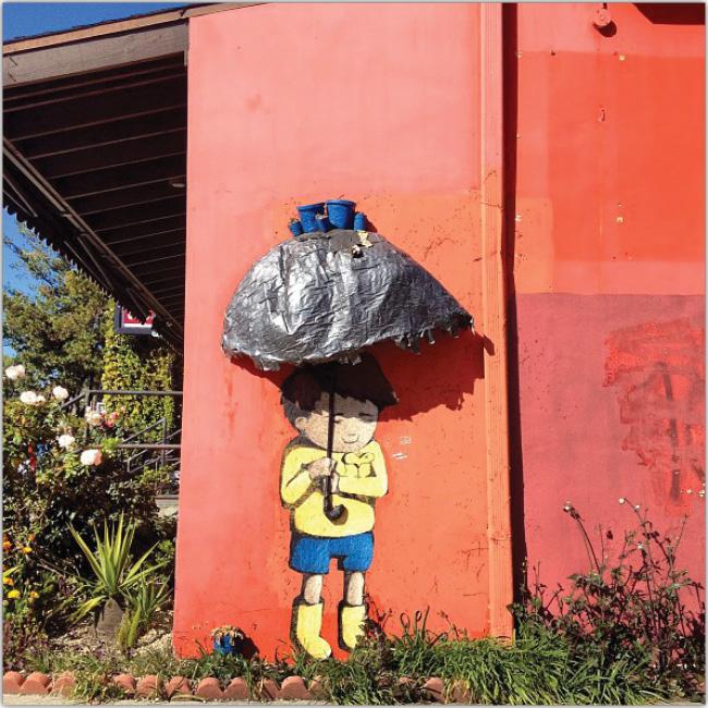 Graffitti de un niño con paraguas