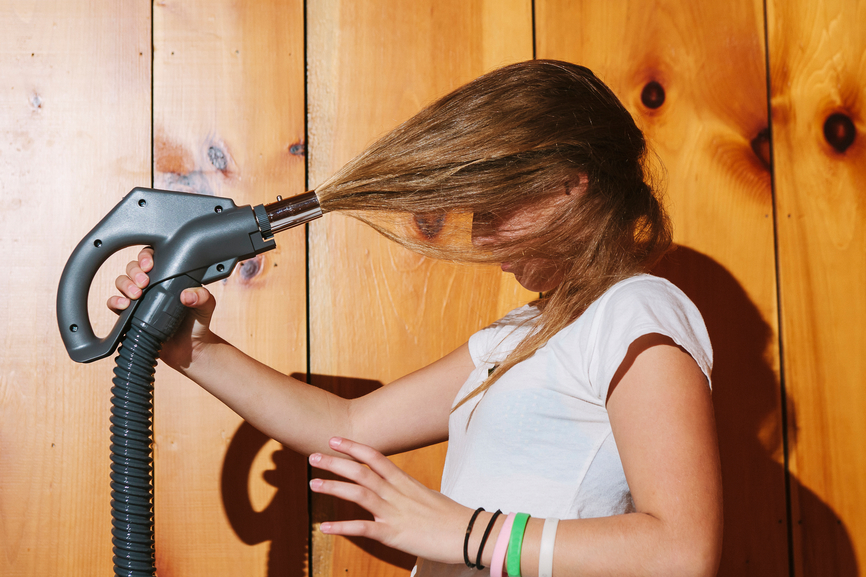 Weird stock photos: vacuum cleaner hair