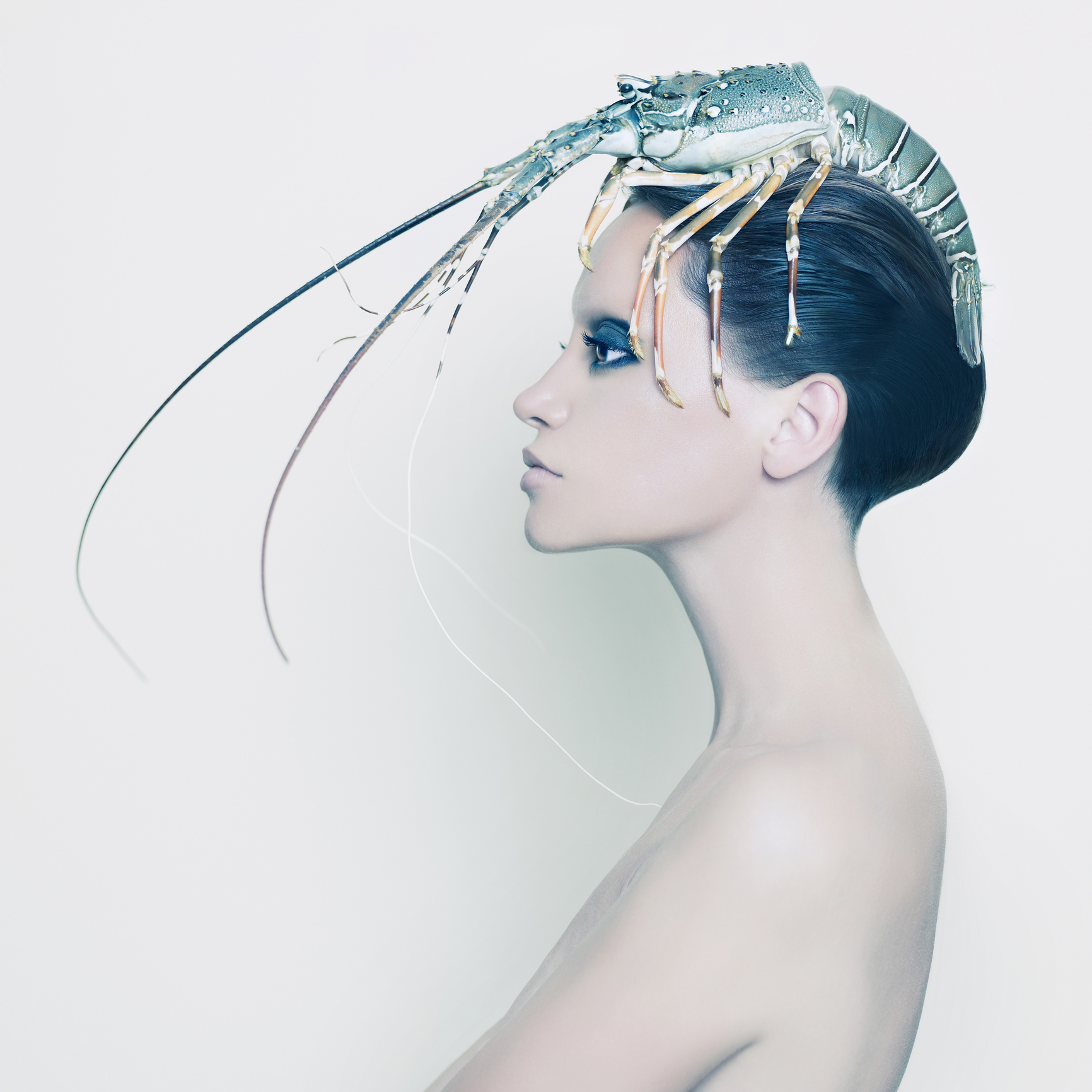Unusual stock pic: woman with a shellfish on her head