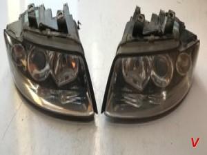 Фара левая Audi A4B6 HG75302081