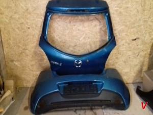 Бампер задний Mazda 2 HG75130425
