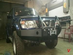 Nissan Patrol Бампер передний HG79558384