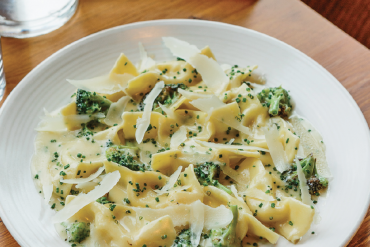 Ancient Dairy's Isabella Scarpinocc with broccoli.