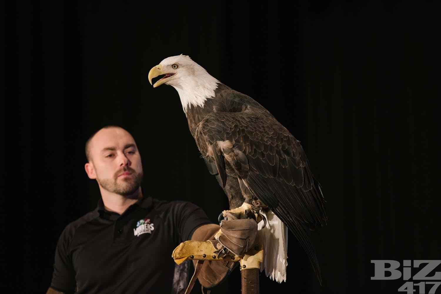 Ben Brandell holds Capella the bald eagle. Photo by Brad Zweerink