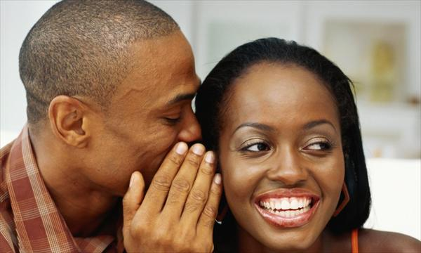 Pheromones Research. How can You Make a Girl Fall in Love Black-man-whispering-woman-ears